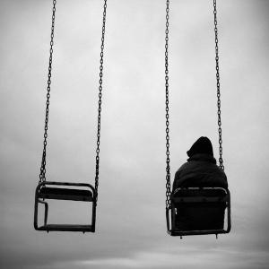 Boy alone on swing